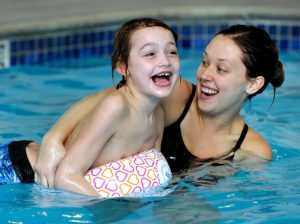 swimming, benefits of teaching swimming to special needs children, children swim,
