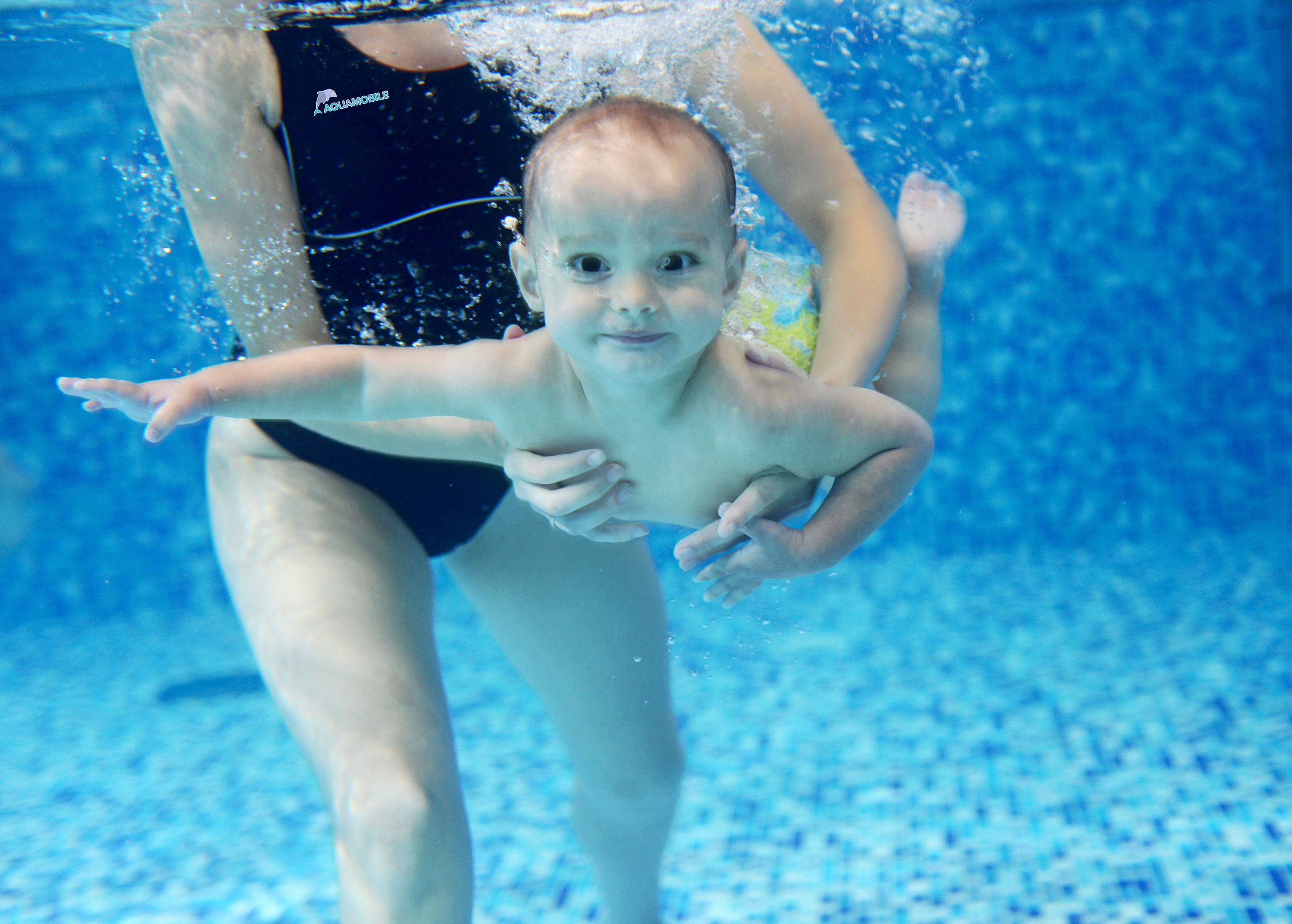 Is it safe to dunk a baby under water? AquaMobile Swim Instructor Teaches Baby to Swim
